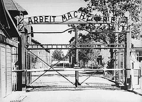 View of the entrance to the main camp of Auschwitz, with sign that says Arbeit Macht Frei.