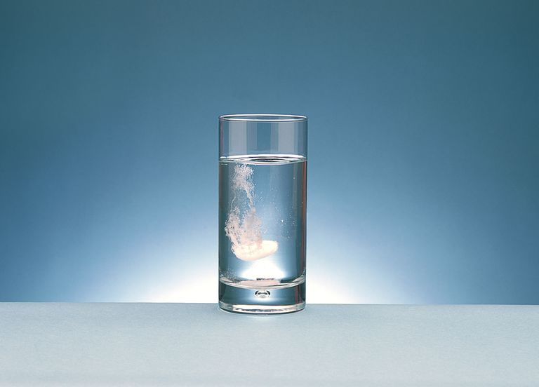 A glass of water with dissolving alka-seltzer