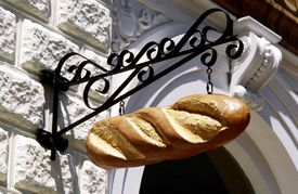 This sculpted loaf of bread is a metonym for the bakery it stands in front of