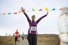 Cheering runner approaching finish line