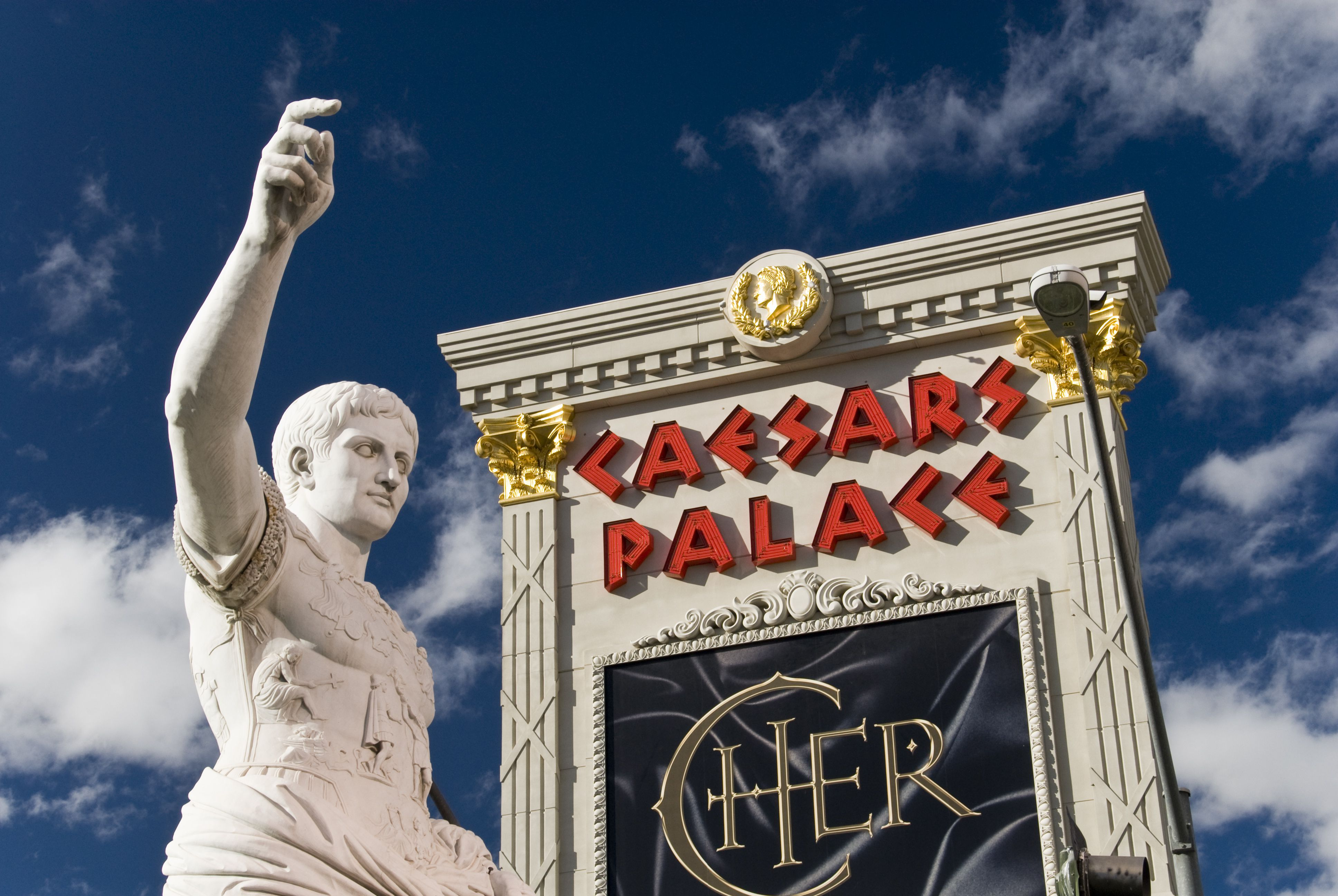 Statue of Julius Caesar by entrance to Caesars Palace casino and hotel on a sunny day.