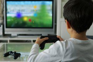 Little boy plays video games.