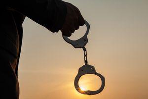 A man holding handcuffs