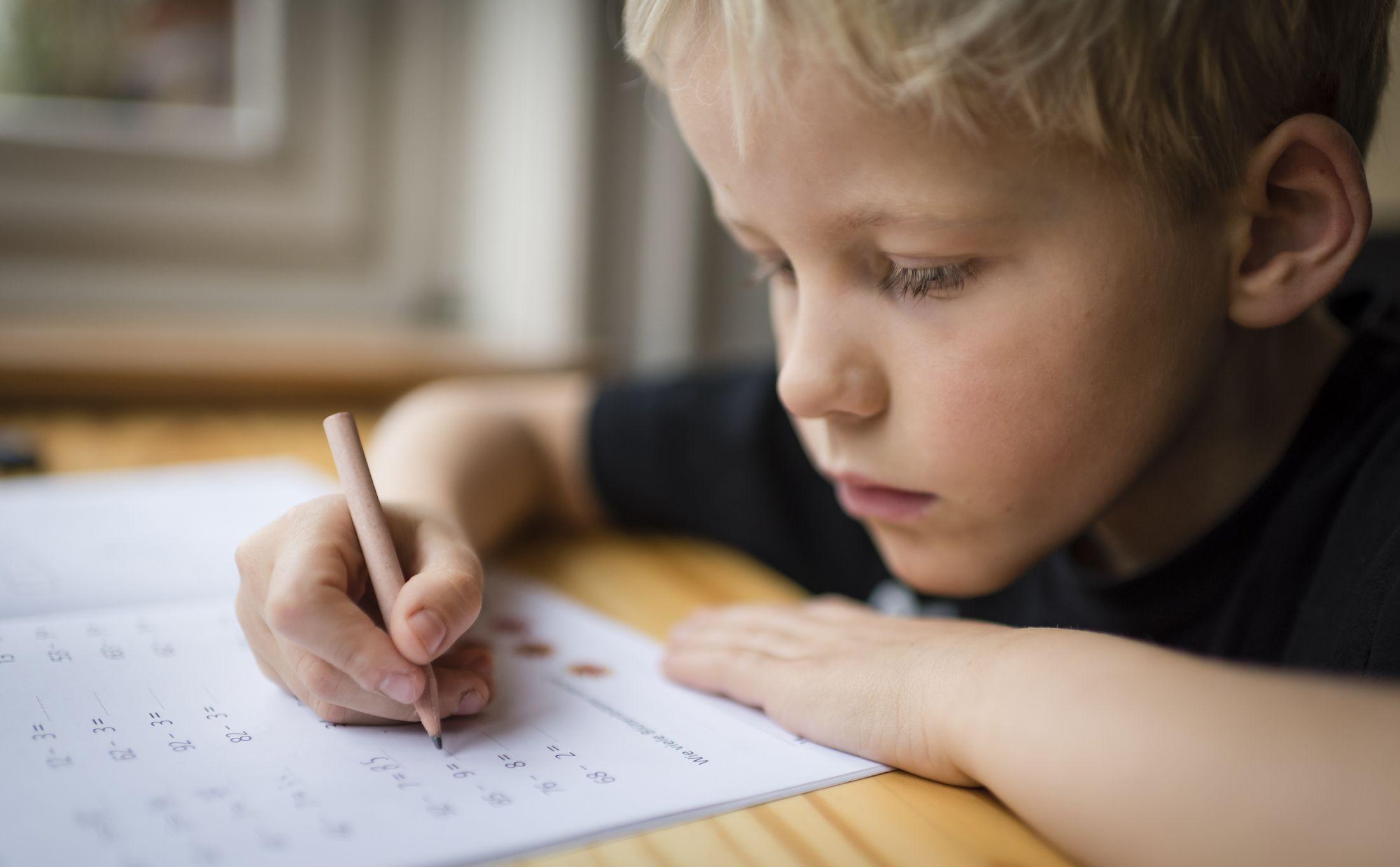 Child working on math homework