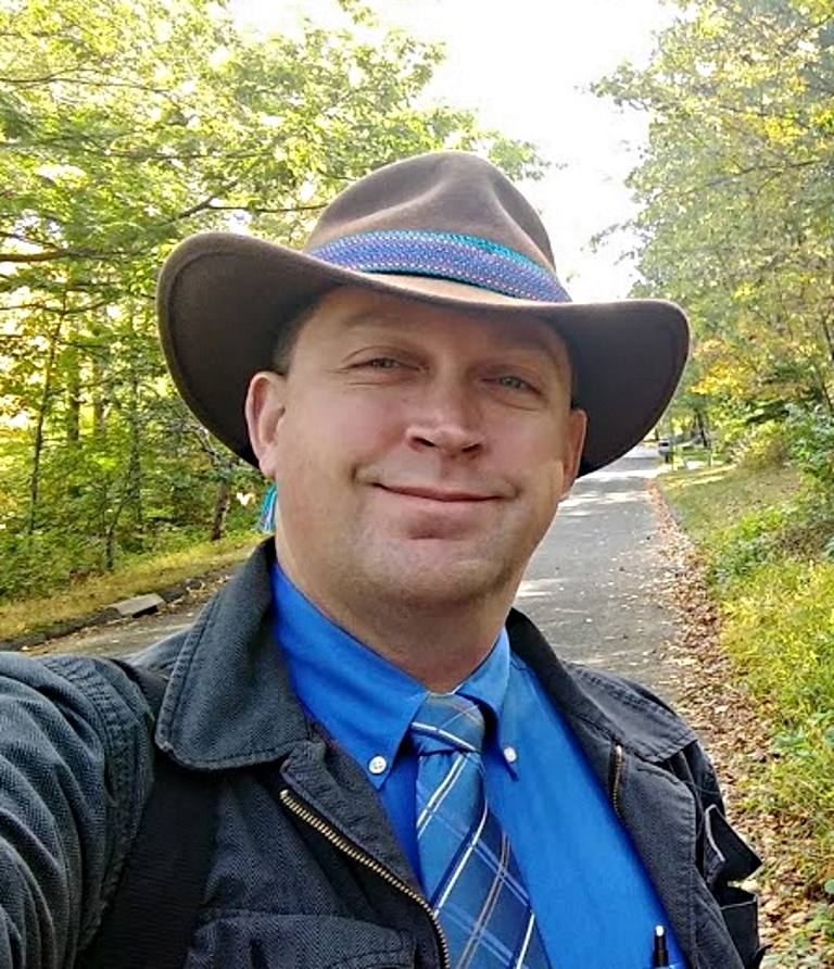 Benjamin Jerew in an Indiana Jones hat with Peruvian hat band, taken on a nice late fall day in the woods.