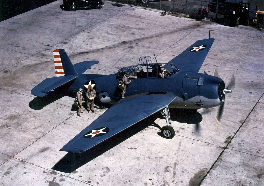 Color photo of a TBF Avenger on the ground.
