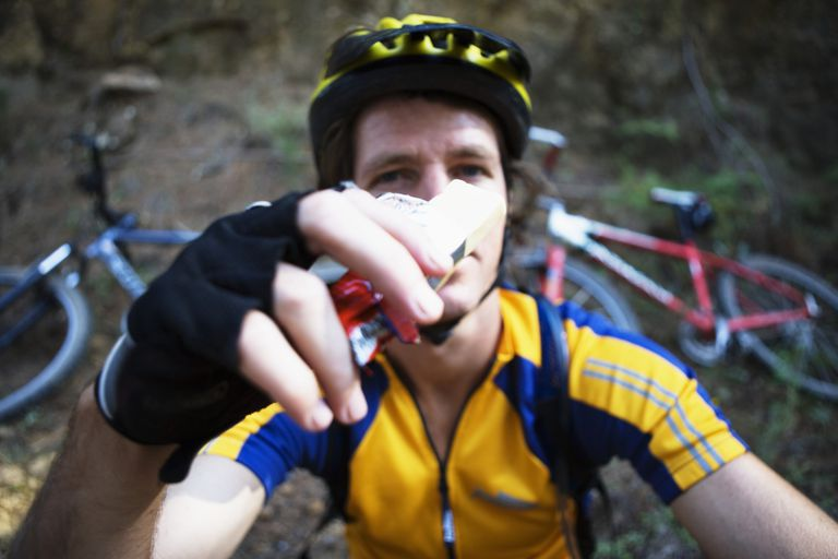 mountain biker eating energy bar