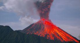 Reventador Volcano erupting at night