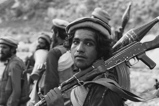 This young Afghan man has a Kalashnikov and an RPG-7 grenade launcher