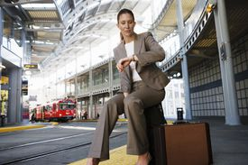 Businesswoman Looking at Watch