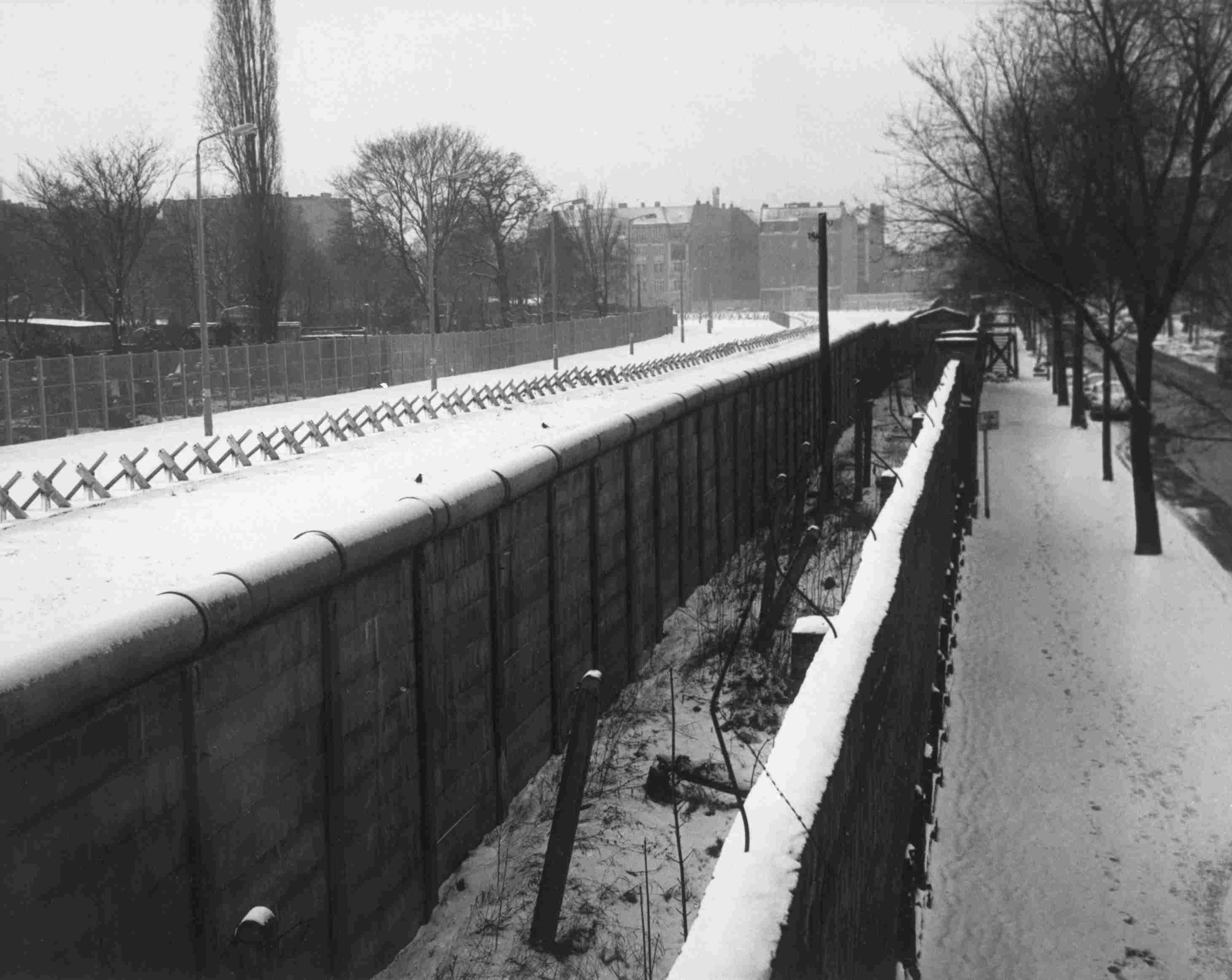 Liebenstrasse View of Berlin Wall with inner wall, trench and barricades.