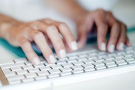 Hands typing on a keyboard
