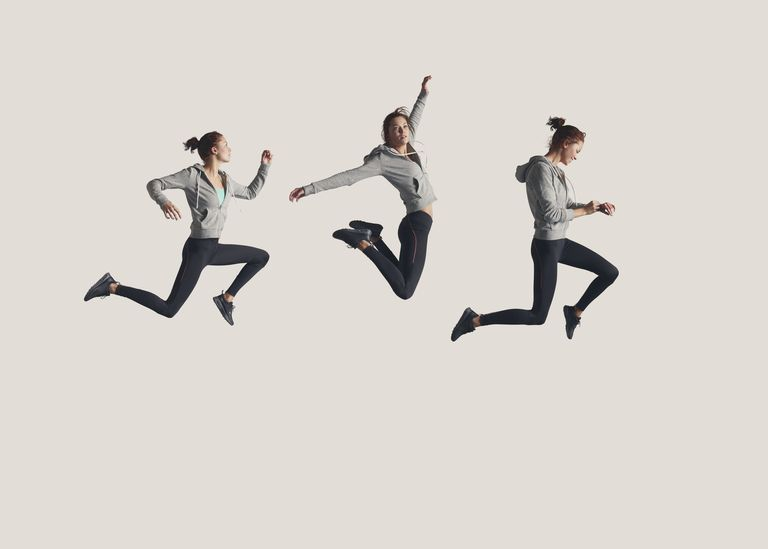 Woman leaping through the air in phases