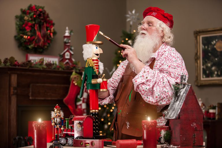 Santa Claus Painting Nutcracker in Toy Shop