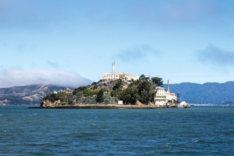 Alcatraz Prison in San Francisco Bay on a sunny day.