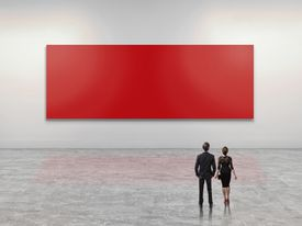 Business people looking at giant red art canvas
