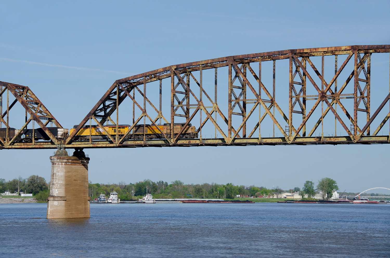 Freight train traveling on bridge, Ohio River near Mississippi River junction, Kentucky, USA
