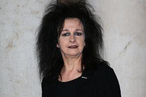 French female architect Odile Decq, April 2012, dark eye shadow, frizzed dark hair, red lipstick