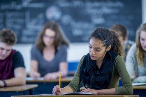 High school students taking a written exam.