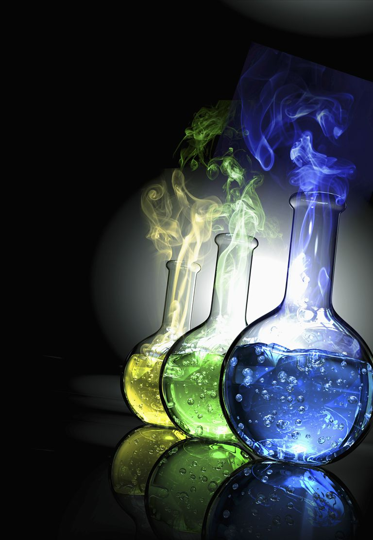 Three laboratory flasks filled with colored liquid