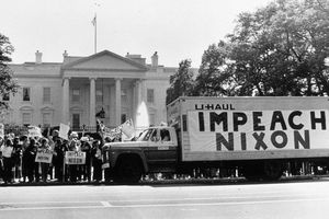 """Old photo of truck with an """"Impeach Nixon"""" banner parked outside the White House"""
