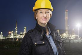 An engineer by a chemical plant