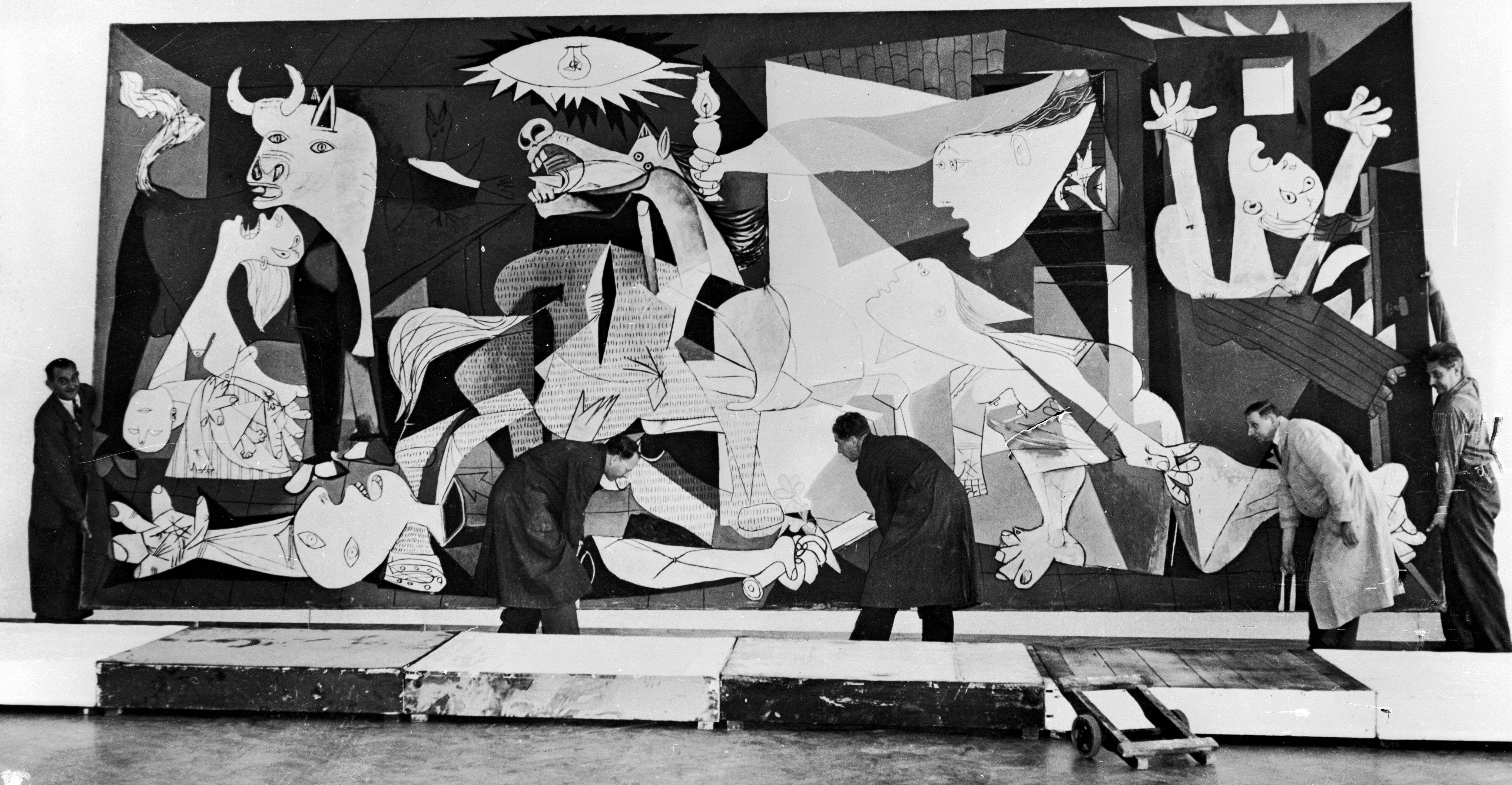 Museum workers hanging Picasso's Guernica