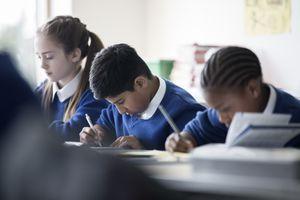 Elementary school children writing in classroom
