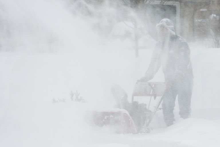 Snow blower in blizzard