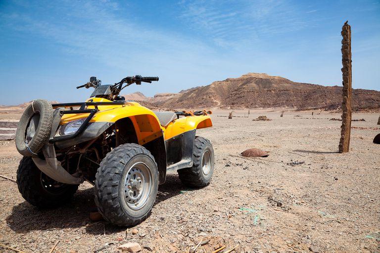 An ATV in a desert field.