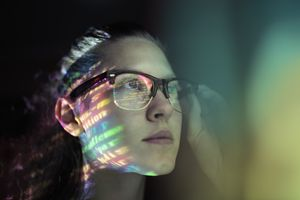 Portrait, girl lighted with colorful code