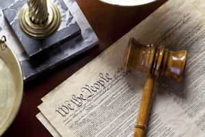 US Constitution with scales of justice and gavel