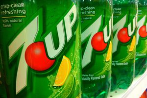 Liter bottles of 7UP on a grocery shelf