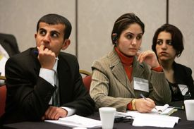 Iraqi law students Rabaz Khurshed Mohammed, Zrian Jamal Hamid and Paiwagt Arif Maruf listen to the team from Sri Lanka make their arguments during the 46th annual Jessup International Law Moot Court Competition March 29, 2005 in Washington, DC.