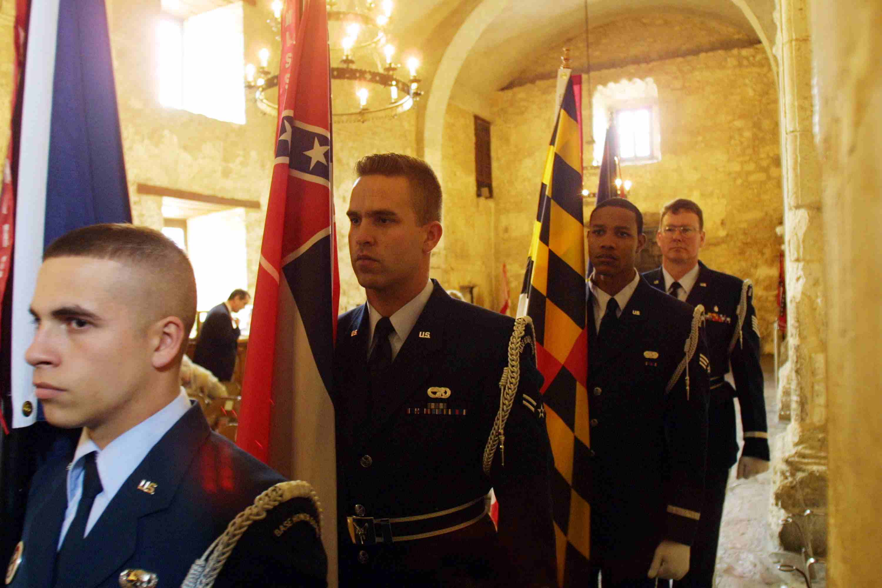 Four men in military processional