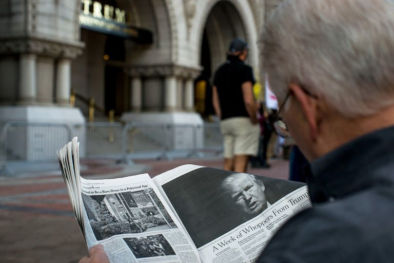 Man reading New York Times