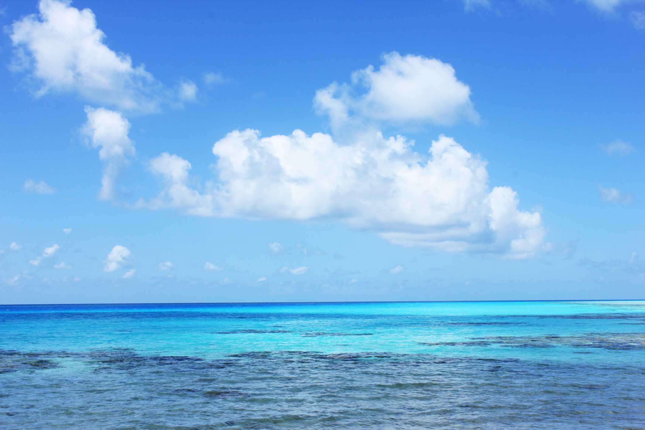Tropical waters, beneath forming maritime tropical air