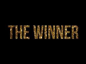 "The words ""The Winner"" in golld glitter"