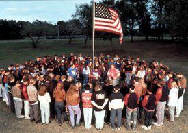 prayer circle around American flag