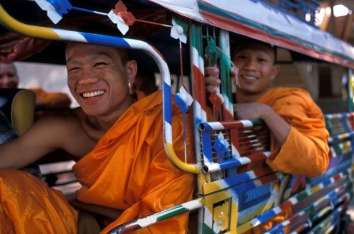 Buddhist monks in a tuk-tuk or motorcycle taxi, Laos.