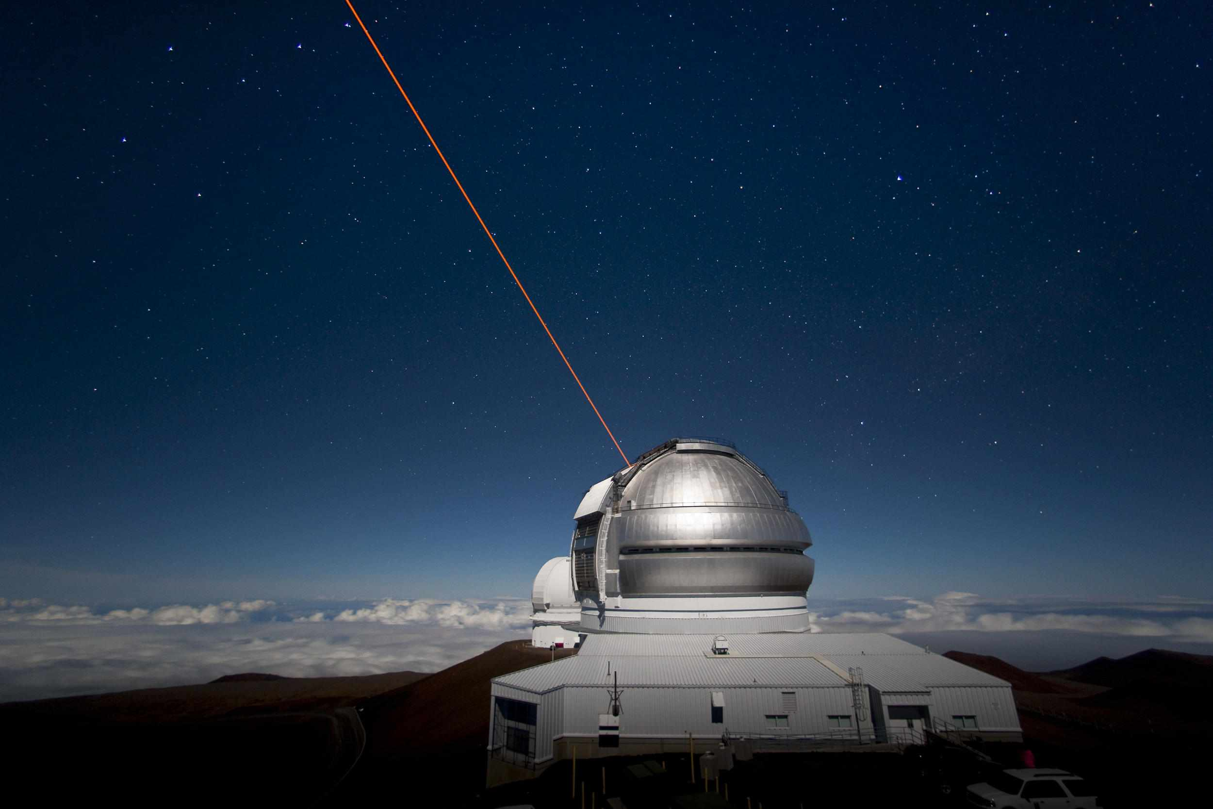 Gemini Observatory North with laser guide star system operating.