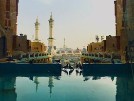 Mosque in Saudi Arabia across a reflecting pond.