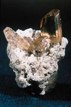 Topaz is a mineral (Al2SiO4(F,OH)2) that forms orthorhombic crystals.