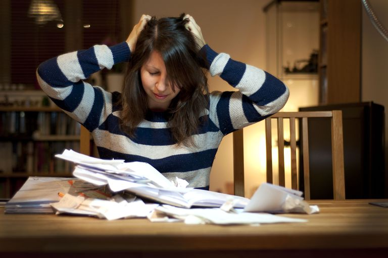 Woman struggling to do her income tax return