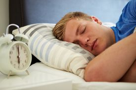 Teenage Boy Sleeping Through Alarm