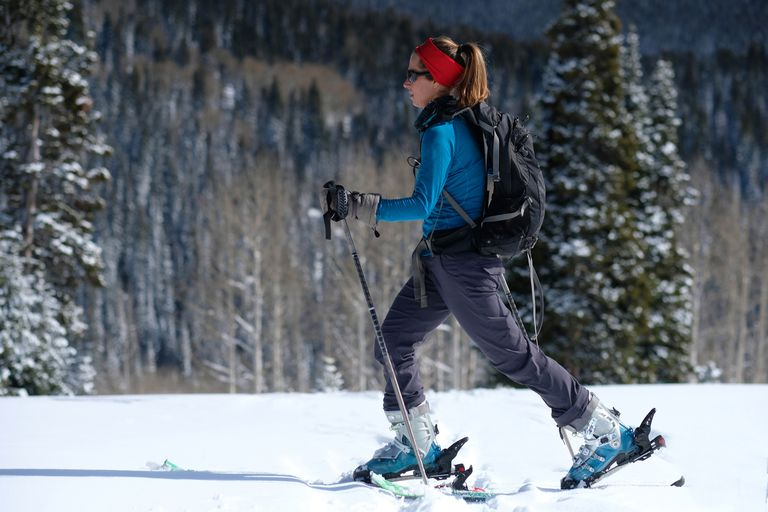 Woman backcountry randonee skiing on Rabbit Ears Pass in Colorado