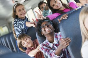 A group of middle school students having fun on the bus