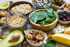 Bananas, spinach, nuts, grains, dried fruits, beans and avocado