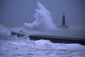 Rough seas breaking over the lighthouse on Roker Pier