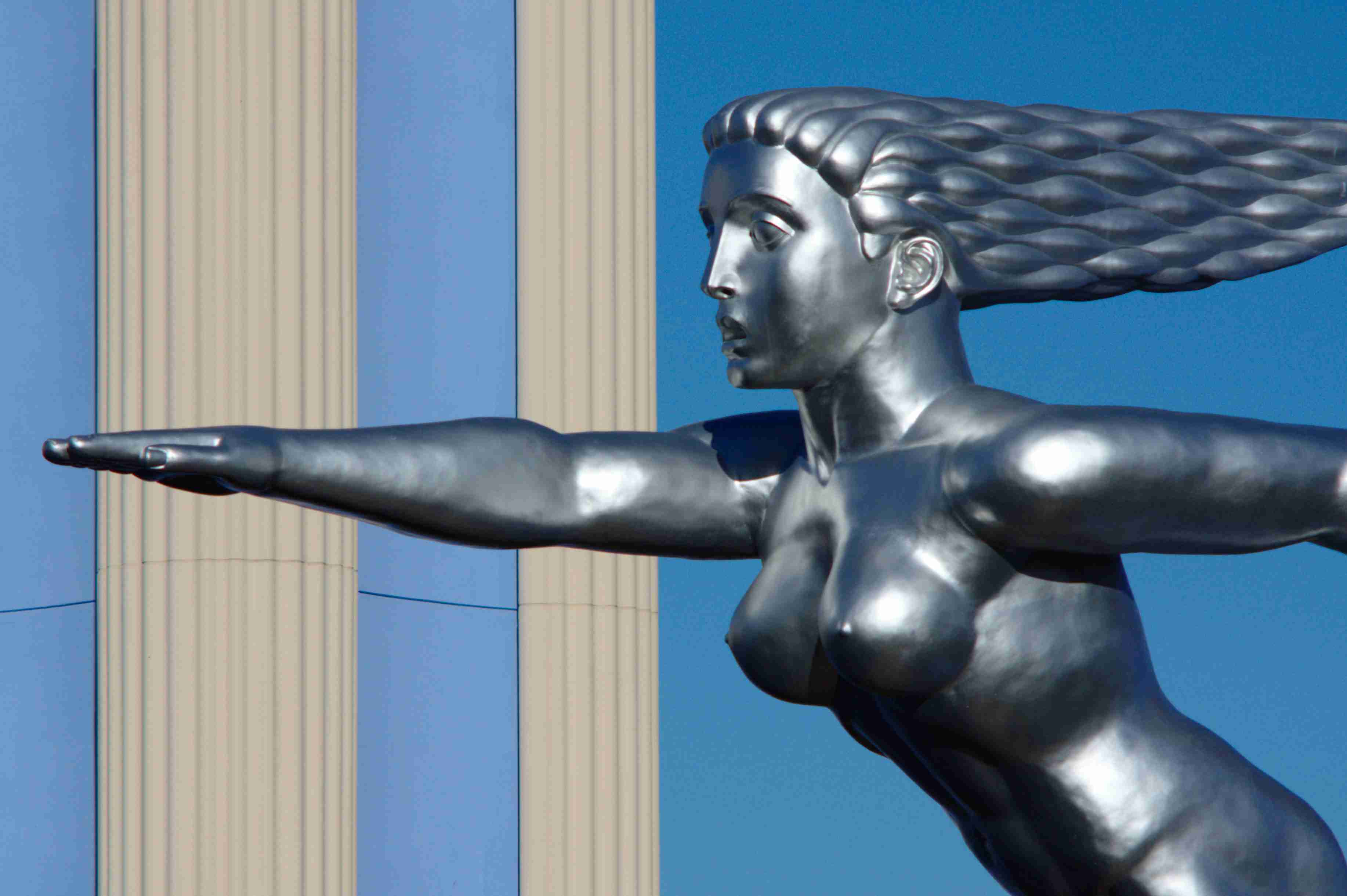 detail of art deco metal sculpture in Fair Park, Dallas, nude woman, hair flowing backwards